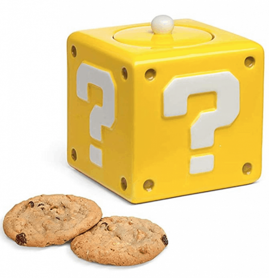 Yellow cube cookie jar with white question mark on each side. Retro kitchen products.