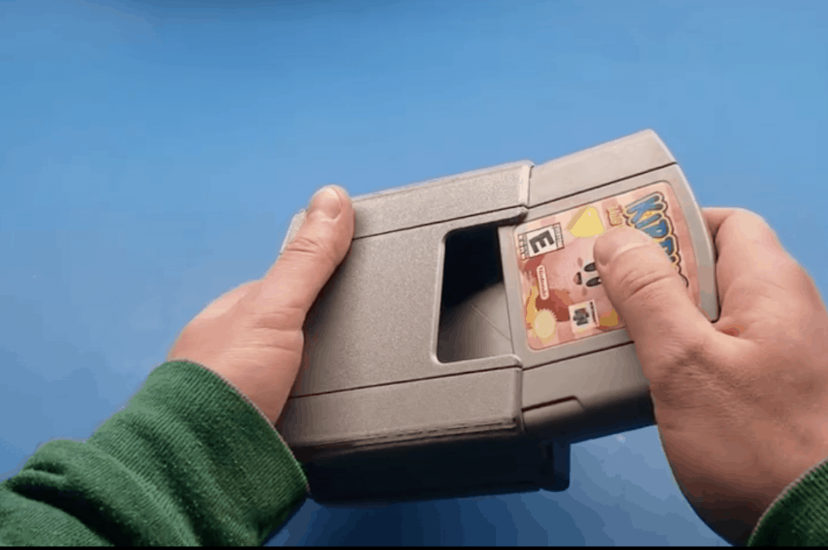 Nintendo 64 Handheld - cartridge going in